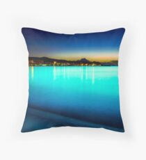 The sea glowed turquoise Throw Pillow
