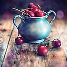 Cup of cherries by jordygraph