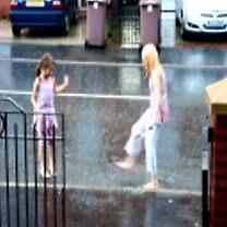 splashing in the rain by mazmedia