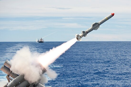 USS Cowpens launches a Harpoon missile from the aft missile deck. by StocktrekImages