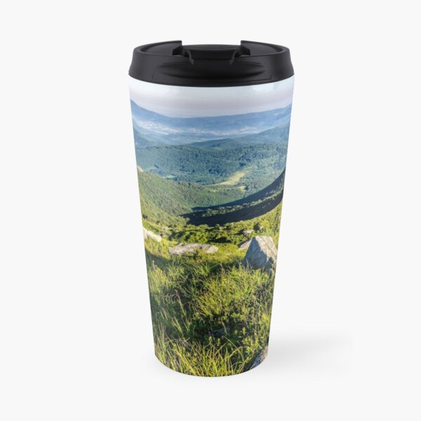 stones on the hill of mountain range Travel Mug
