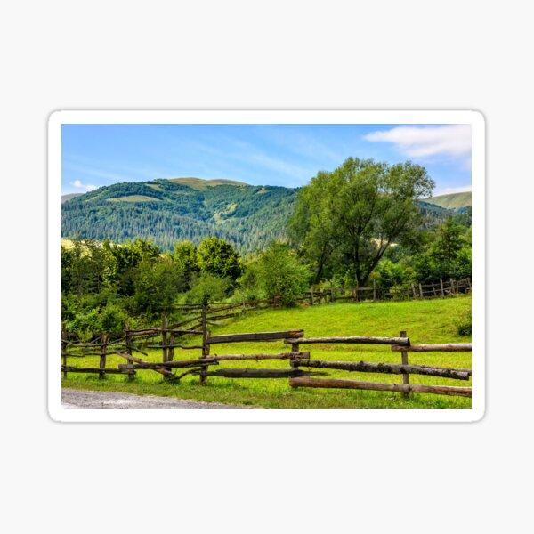 wooden fence on hillside Sticker