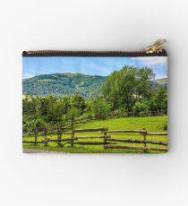 wooden fence on hillside Studio Pouch