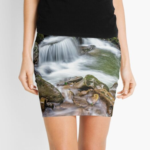 small cascade on the river among bouders Mini Skirt