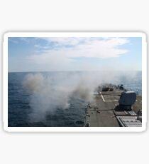 The Mark 45 lightweight gun is fired aboard USS Mahan. Sticker