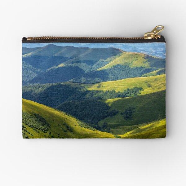 valley between green hills in summer Zipper Pouch