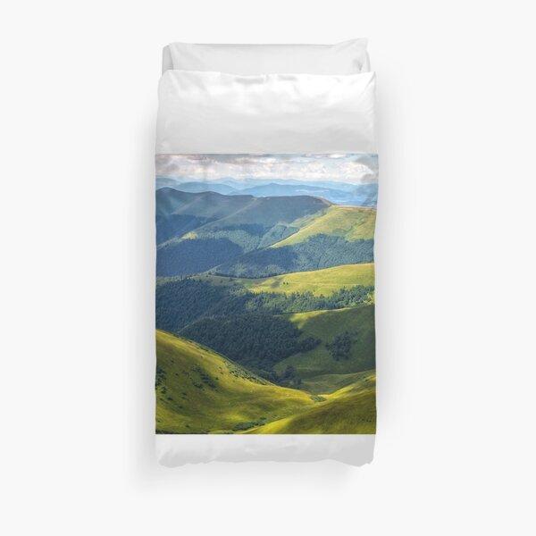 valley between green hills in summer Duvet Cover
