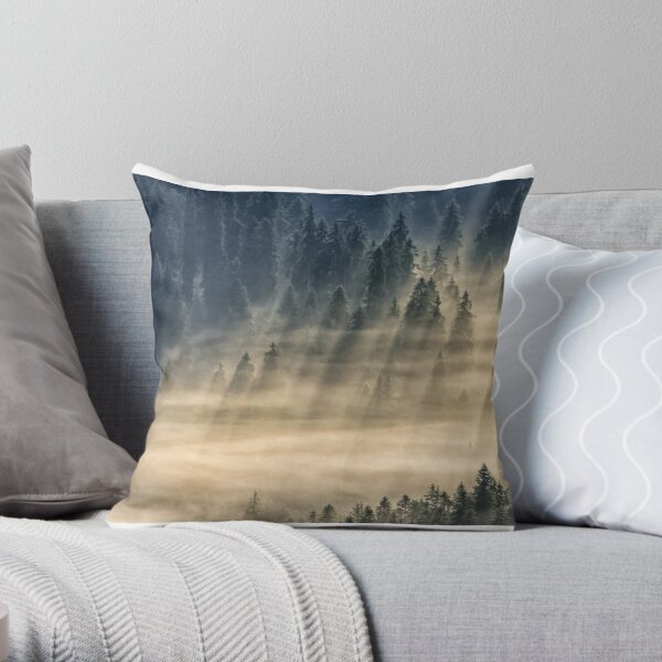 coniferous forest in foggy mountains Throw Pillow
