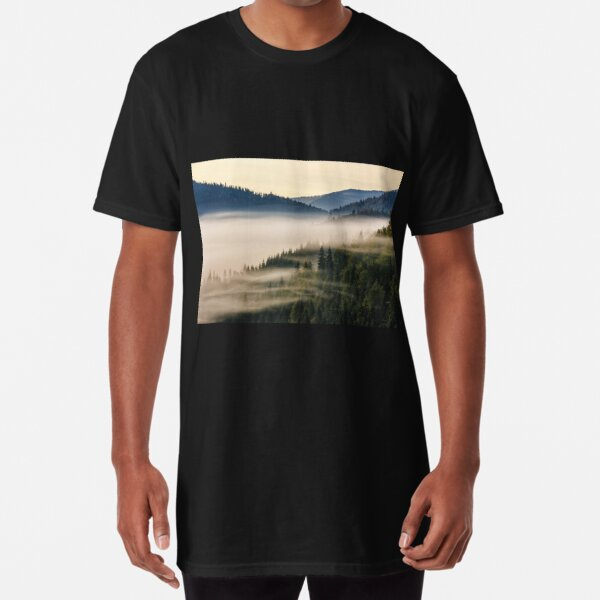 spruce forest on a hill side in fog Long T-Shirt