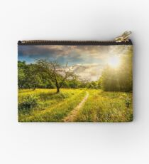 Winter in mountains meets spring in valley at sunset Studio Pouch