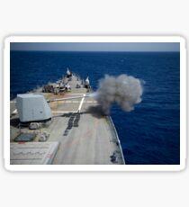A 5-inch gun is fired aboard USS Roosevelt. Sticker