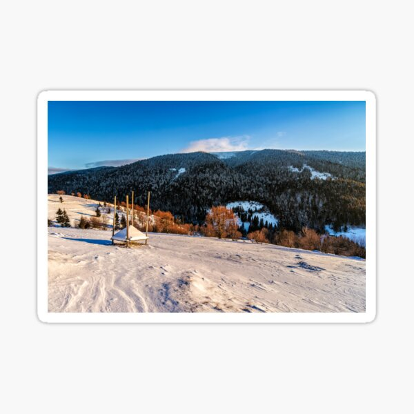 woodshed on the hillside in winter mountains Sticker