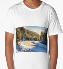 snowy road through spruce forest in mountains Long T-Shirt