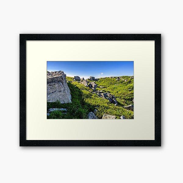 huge stones in valley on top of mountain range at sunrise Framed Art Print