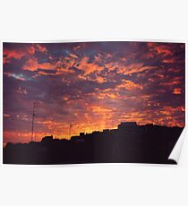 Sunset in the city with clouds Poster