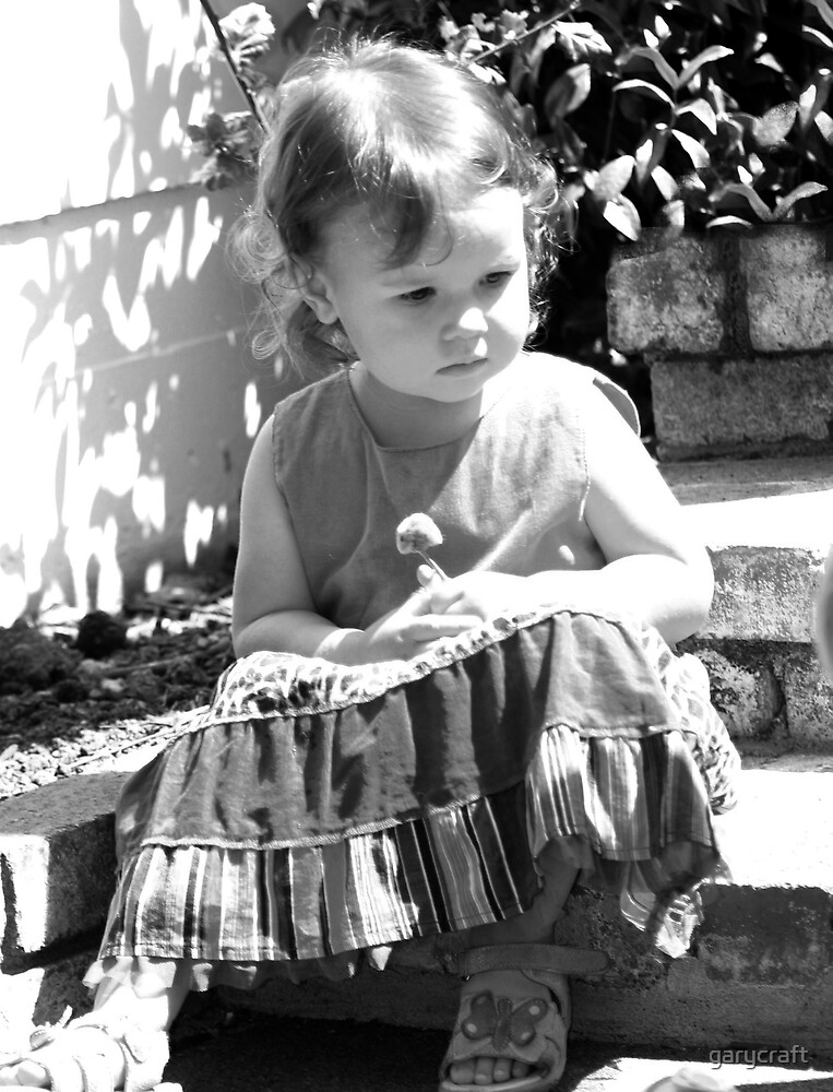 BLACK AND WHITE OF ZOE SITTING ON THE STEPS by garycraft