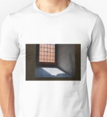 Window with bars leaving a shadow Unisex T-Shirt