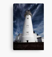 Flamborough Head Lighthouse against blue skies Canvas Print