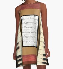Piano keys with sheet music by Kristie Hubler A-Line Dress