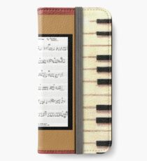 Piano keys with sheet music by Kristie Hubler iPhone Wallet/Case/Skin