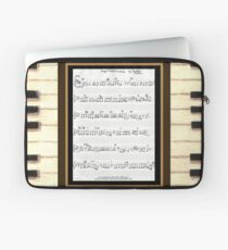Piano keys with sheet music by Kristie Hubler Laptop Sleeve