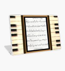 Piano keys with sheet music by Kristie Hubler Laptop Skin
