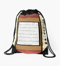 Piano keys with sheet music by Kristie Hubler Drawstring Bag