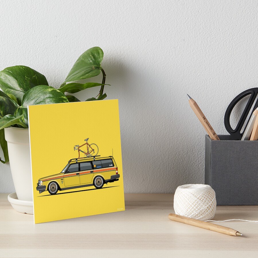 Yellow Volvo 245 Wagon With Roof Rack and Vintage Bicycle\