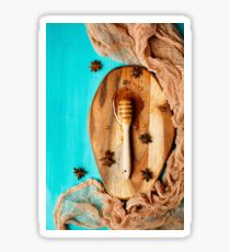 Honey with special spoon on a chopping board Sticker