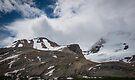 Cloud and Snow Capped Peaks in Jasper National Park, Alberta by Gerda Grice