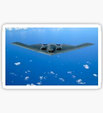 A B-2 Spirit soars through the sky after a refueling mission. Sticker
