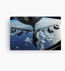 A KC-135 Stratotanker aircraft refuels a B-52 Stratofortress aircraft over the Pacific Ocean. Canvas Print
