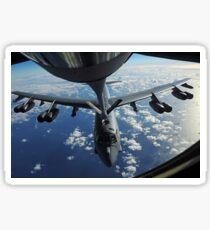 A KC-135 Stratotanker aircraft refuels a B-52 Stratofortress aircraft over the Pacific Ocean. Sticker