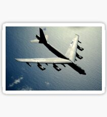 A B-52 Stratofortress in flight over the Pacific Ocean. Sticker