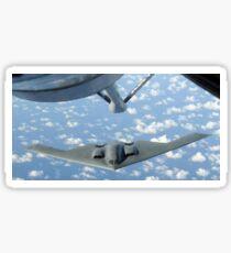 A B-2 Spirit approaches the refueling boom of a KC-135 Stratotanker. Sticker