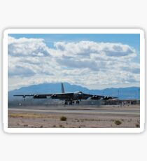A B-52 Stratofortress takes off from Nellis Air Force Base. Sticker