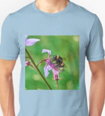Bumble bee gets stuck in to an orchid T-Shirt