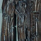 Pew Carving front view of man and angel Cathedral Lausanne Switzerland 19840817 0024 by Fred Mitchell