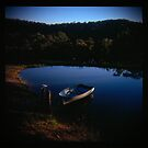 Holga madness.... little boat and reflection in daniland by Juilee  Pryor