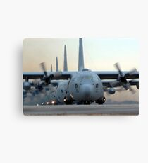 C-130 Hercules aircraft taxi out for a mission during a six-ship sortie. Canvas Print