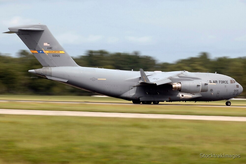 A C-17 takes off from Charleston Air Force Base, South Carolina. by StocktrekImages