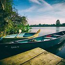 Row Boat and Canoe tethered on the River Thames by heidiannemorris