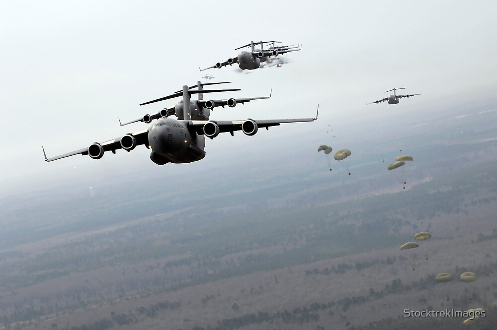 C-17 Globemaster IIIs participate in a large formation exercise. by StocktrekImages