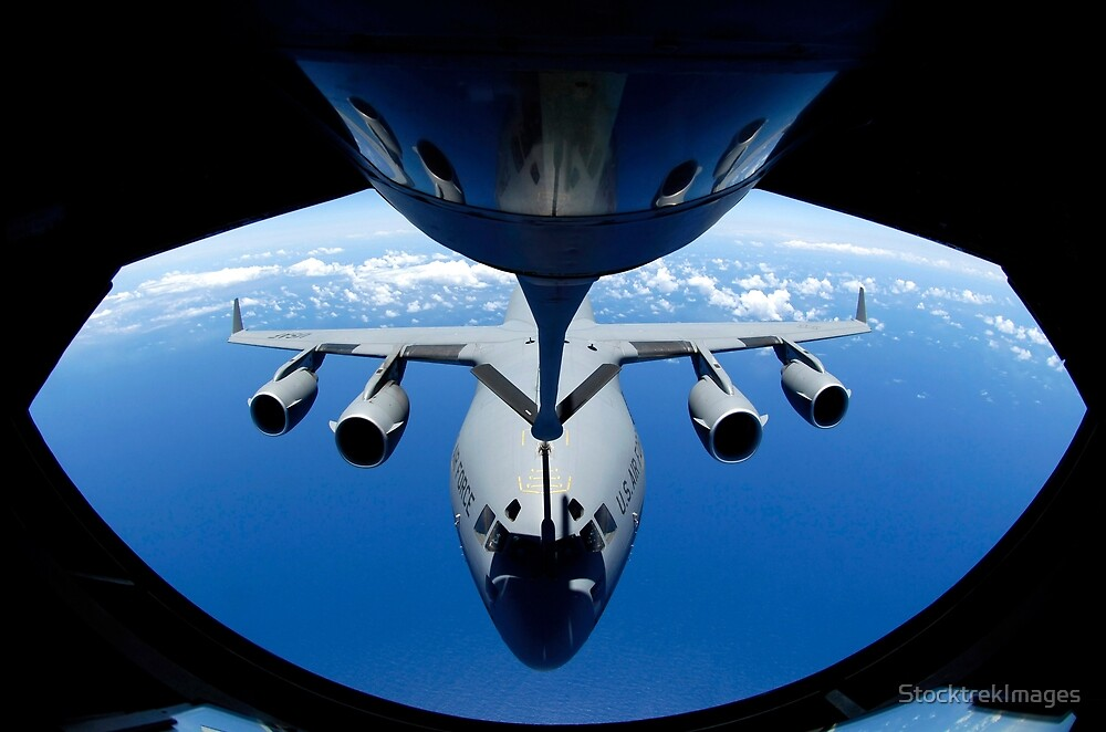 A C-17 Globemaster III receives fuel from a KC-135 Stratotanker. by StocktrekImages