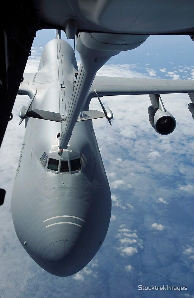 A KC-10 Extender prepares to refuel a C-5 Galaxy. by StocktrekImages