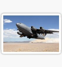 A C-17 Globemaster departs from the Tonopah runway. Sticker