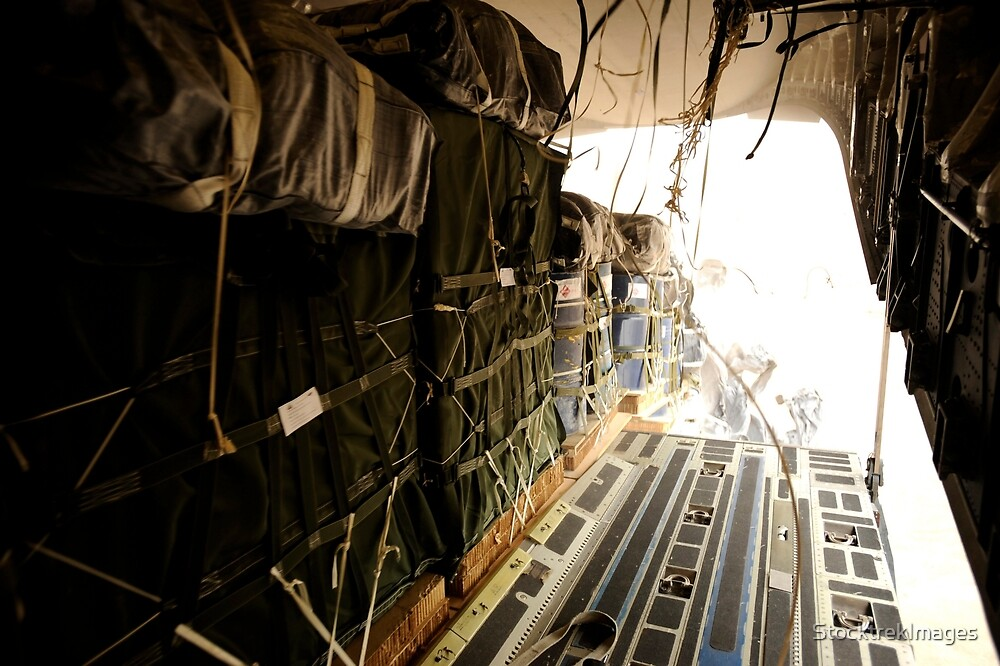 Container delivery system bundles drop out of a C-17 Globemaster III over a drop zone in Afghanistan. by StocktrekImages