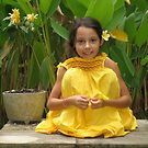 Young girl with frangipangi flower by Ronald Wigman