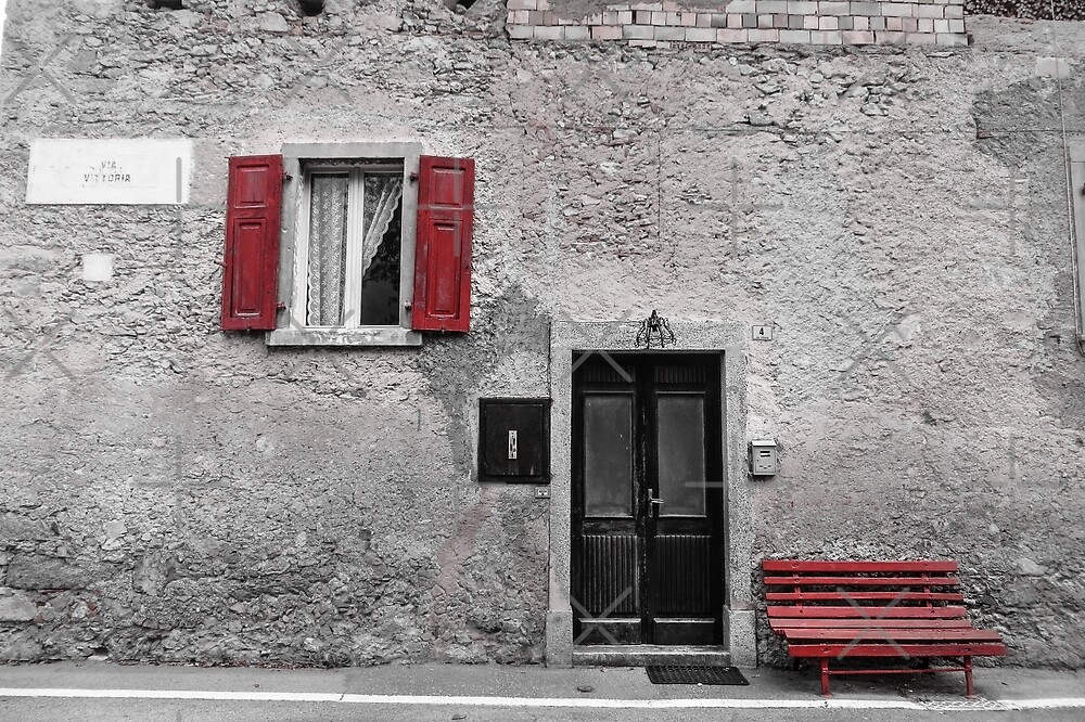 Grey house, red bench by Althea Gianera