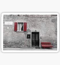 Grey house, red bench Sticker